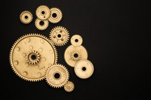 photo-of-golden-cogwheel-on-black-background-3785932
